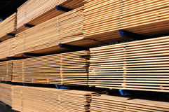 Lumber at a sawmill. Stack of boards in lumber yard and loader Royalty Free Stock Photos