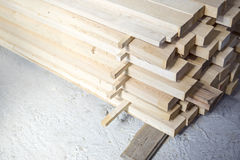 Lumber stacked at a construction site Stock Image