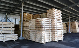 Lumber stacked in piles in stock. Stacks of lumber for the construction of stacked in a warehouse Royalty Free Stock Photo