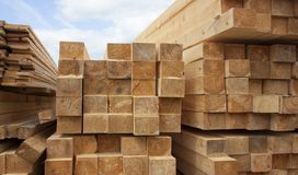 Free Lumber Warehouse. Wood Planks And Timber Stacked In Stacks Outdoors Royalty Free Stock Image - 160124926