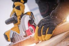 Lumber Woodwork Tools. Wood Construction. Circular Saw in Action stock photos