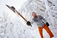 Lumberjack ax swings Stock Photos