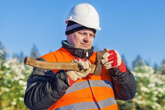 Lumberjack check the sharpness of the ax Royalty Free Stock Images