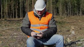 Lumberjack counting euro banknotes in forest stock video