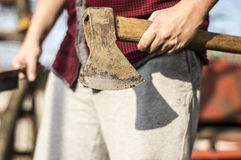 Lumberjack. Cutting down the tree whit an ax Stock Photography