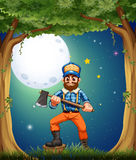 A lumberjack at the forest in the middle of the night Stock Images