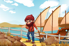 A lumberjack holding an axe near the sea Stock Image