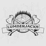 Lumberjack logo, t-shirt design with illustrated wood, trees, axes and ribbon. Hand drawn illustration. Royalty Free Stock Photography