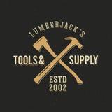 Lumberjack narzędzia i dostawa rocznika Abstrakcjonistyczna etykietka Zdjęcia Stock