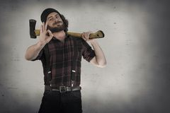 Lumberjack Okay Sign. Silly hipster lumberjack gives okay sign while holding axe Stock Photography