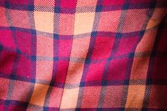 The texture of the red wool plaid fabric stock image