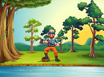 A lumberjack at the riverbank holding an axe Stock Photography