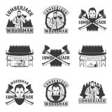 Lumberjack set of vector vintage emblems, labels, badges and logos in monochrome style on white background Stock Photos