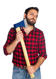 Lumberjack shaves his beard with the ax blade Stock Photos