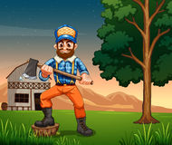 Lumberjack standing near the tree Royalty Free Stock Photo