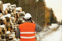 Lumberjack  talking on a mobile phone Stock Photos