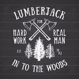 Lumberjack vintage label with two axes and trees. Hand drawn textured grunge vintage label, retro badge or T-shirt typography desi Royalty Free Stock Image