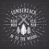 Lumberjack vintage label with two axes and trees. Hand drawn textured grunge vintage label, retro badge or T-shirt typography desi Royalty Free Stock Images