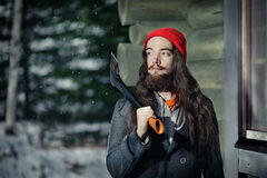 Lumberjack in a winter forest Royalty Free Stock Photography