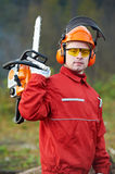 Lumberjack Worker With Chainsaw In The Forest. Lumberjack Worker in protective safety work wear With Chainsaw at Forest royalty free stock images