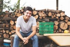 Lumberjack. Young lumberjack sitting and smile looking at camera Royalty Free Stock Image