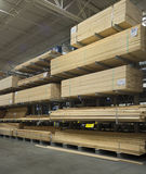 Lumberyard. Commercial  indoor lumberyard with carts in front of lumber Royalty Free Stock Photos