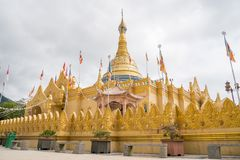 Lumbini Natural Park, Berastagi, Indonesia. Lumbini Natural Park in Berastagi, North Sumatra, Indonesia.  Buddhist temple with gold color surrounded with Stock Photography