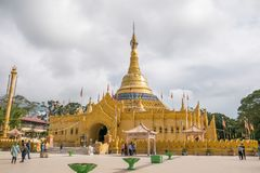 Lumbini Natural Park, Berastagi, Indonesia. Lumbini Natural Park in Berastagi, North Sumatra, Indonesia.  Buddhist temple with gold color surrounded with Royalty Free Stock Photo