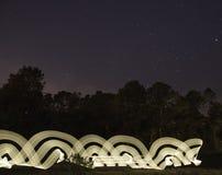 Lumière blanche abstraite de tache floue de mouvement photographie stock libre de droits