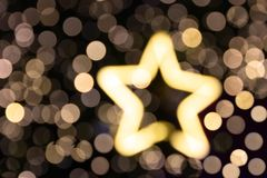 Lumière brouillée d'étoile de glittler de Noël pour le fond photographie stock libre de droits