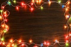 Lumière colorée sur la texture en bois pour Noël Photo libre de droits