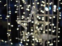 Lumière d'étoile et fond de Bokeh Photo stock