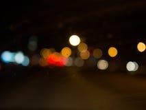 Lumière de Bokeh à l'arrière-plan foncé Photographie stock