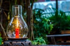 Lumière de bougie en verre Photographie stock libre de droits