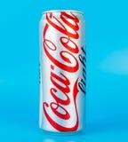 Lumière de coke sur le fond bleu Images stock