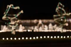 Lumière de Noël de fond de tache floue photographie stock