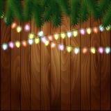 Lumière de Noël sur le fond en bois illustration libre de droits