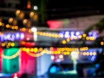 Lumière de nuit, lumière de Bokeh de coloré à la rue de marche Photos libres de droits