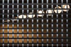 Lumière derrière des barres Images stock