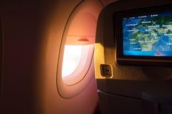 Lumière du soleil de l'avion de hublot - image courante Photos stock