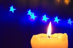 Lumière et étoiles de bougie Image stock
