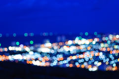 Lumière et ciel nocturne de tache floue Photographie stock libre de droits