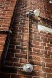 Lumière extérieure sur un mur de briques Photos libres de droits