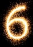 Lumière numéro 6 de feu d'artifice de cierge magique d'isolement sur le noir Photo stock