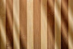 Lumière sur le bois en bambou Images libres de droits