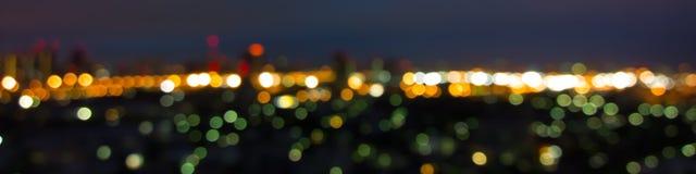 Lumières abstraites brouillées de fond, paysage urbain d'horizon Image stock