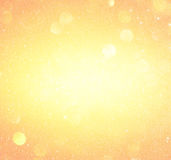 Lumières abstraites de bokeh d'orange et d'or Fond Defocused image stock