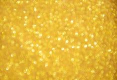 Lumières abstraites Defocused d'or images stock