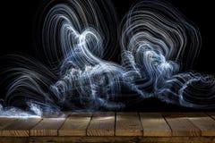 Lumières abstraites sur le bois Photo stock