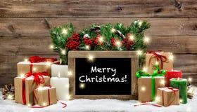 Lumières brûlantes de boîte-cadeau de bougies de décoration de vintage de Noël Images libres de droits
